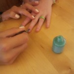 Co-leader Ritzi polishing nails...