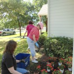 Betty and Katie working on n flowerbed